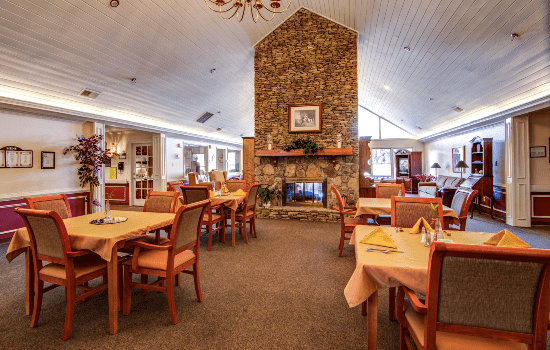 spacious restaurant style dining room with a fire place
