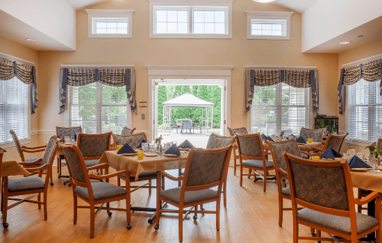 restaurant style dining room with high ceilings and many windows