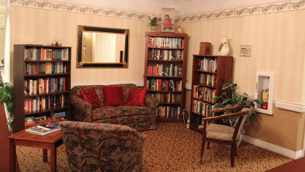 library with many books and reading chairs