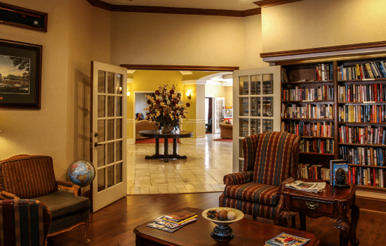 library with many books and lounge chairs