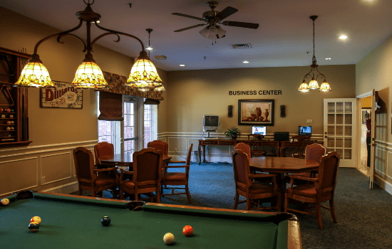 a room with tables and a billiards table
