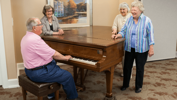 a resident playing the piano in the lounge