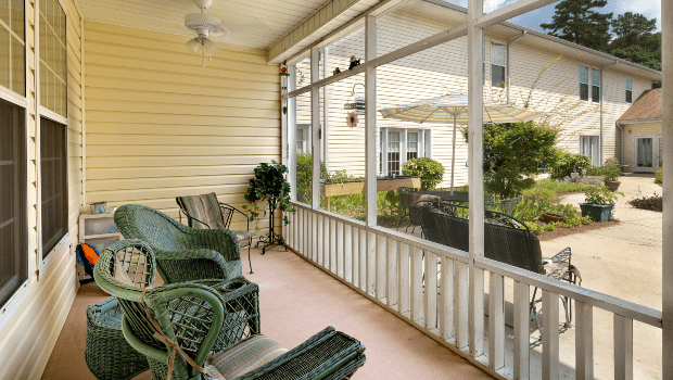 long outdoor porch with lounge chairs