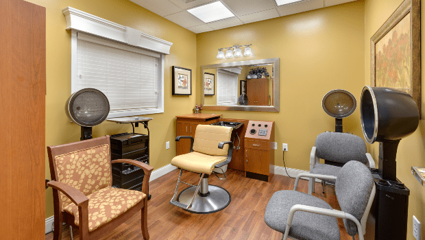 beauty salon with a couple hair treatment stations