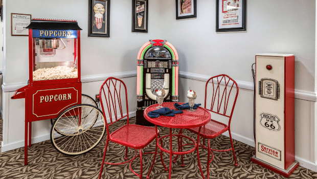 a cool room with a popcorn machine and a table for two