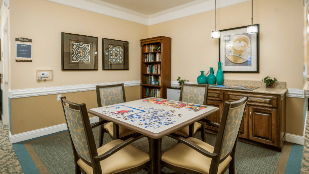 quiet game room with a large table for puzzles
