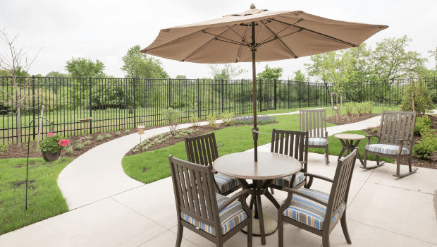 backyard patio with tables and large umbrellas