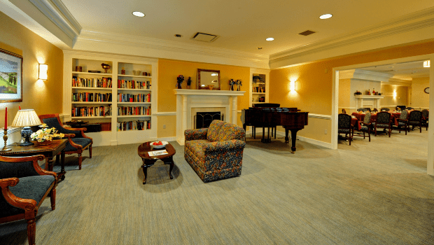spacious lounge with book shelves and comfortable seating