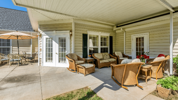 outdoor porch with an overhang and nice chairs