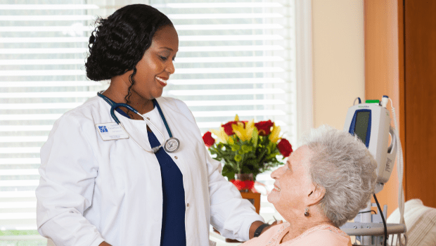 a nurse talking to a resident