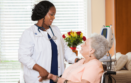 a nurse speaking with a resident