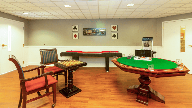 game room with a large green cards table