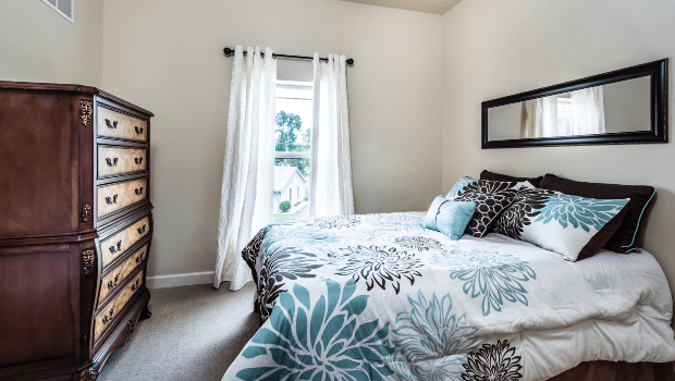 bedroom with a large white and blue bed