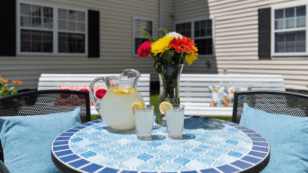 a table with lemonade on the patio