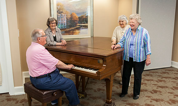 residents around a piano
