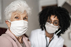 woman and doctor wearing masks