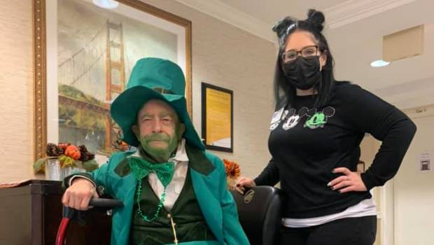 Resident and Employee celebrating St Patrick's Day