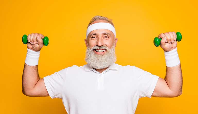 older man working out with green weights