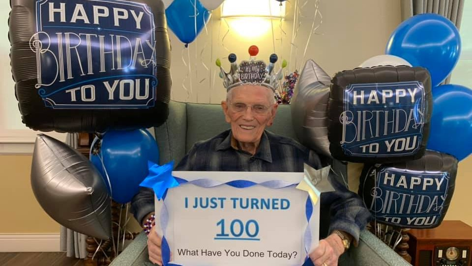 a very happy man on his 100th birthday