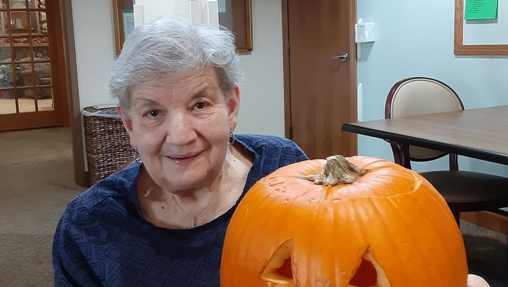 a resident with a nicely carved pumpkin