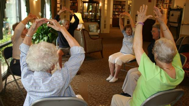 residents doing a group stretch