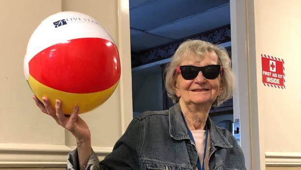 a woman taking a picture with beach ball