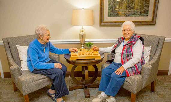 two women playing checkers