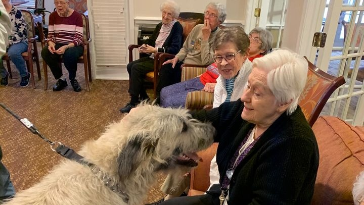 a happy resident with a furry friend