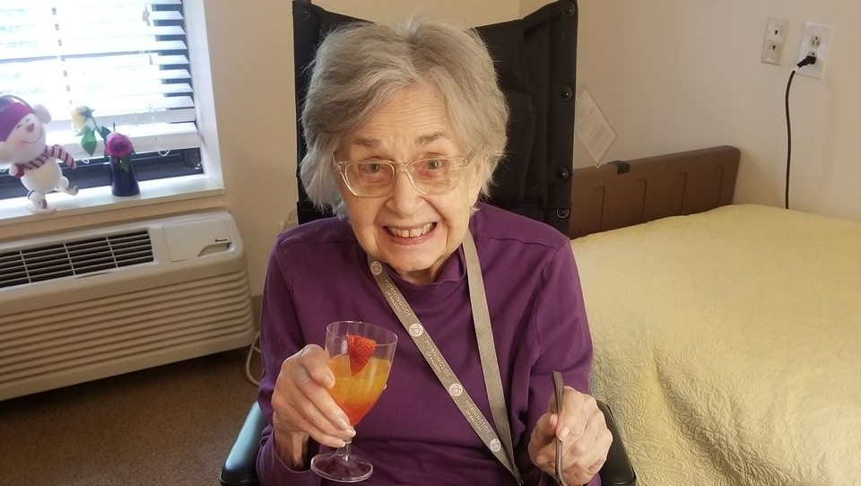 a very happy resident with a delicious drink