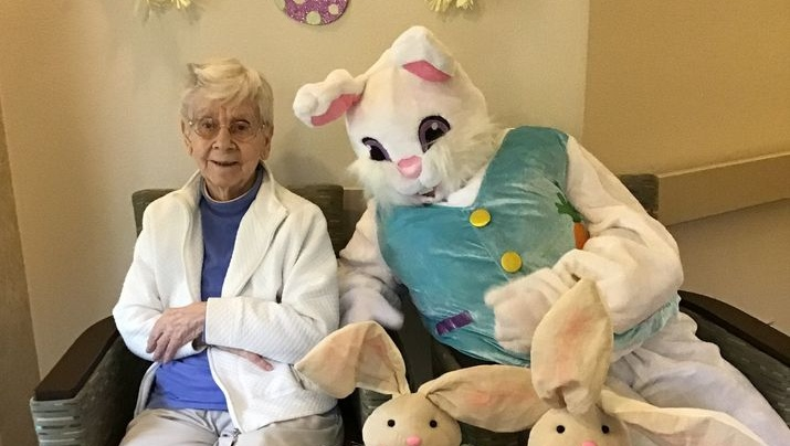 a happy resident with the Easter bunny