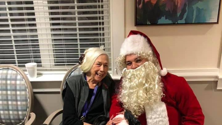 a happy resident with santa on christmas